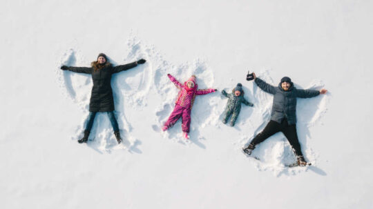 Family making a snow angel